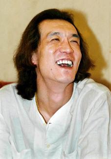 李咏谈个人收入 工资奖金每月共扣7000多元税